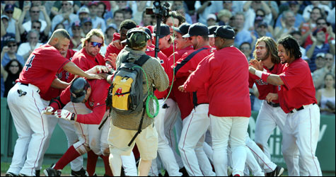 Jason Varitek squirts out of the mob at home plate that had gathered to celebrate the catcher's walkoff homer.