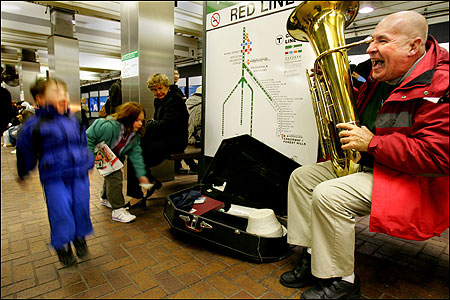 'You see the same people every day,' says tuba player Bill Meehan (above, at Park Street station). 'It's almost a ministry, in a way. It makes people happy.' (Globe Photo / Laurie Swope) photos: Boston street musicians