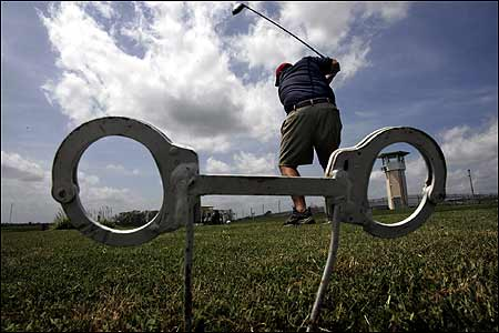 Having a golf course at a prison means that inmates install the sprinkler system and oversized handcuffs mark the tees.