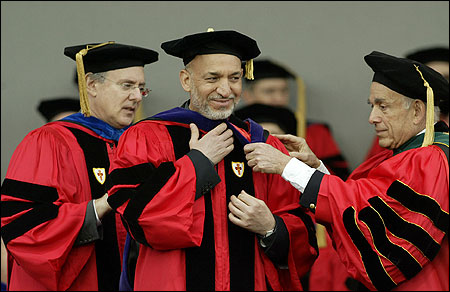 Afghanistan President Hamid Karzai (center) recieves an honorary degree from Alan Leventhal, Chairman of the Board of Trustees, and Dr. Aram Chobanian, President ad interm Boston University, during the school's graduation ceremony.