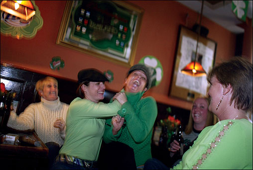 Lorraine Gwynn (left) and her sister Ann Marie Prakapas have some fun at the popular L Street Tavern.