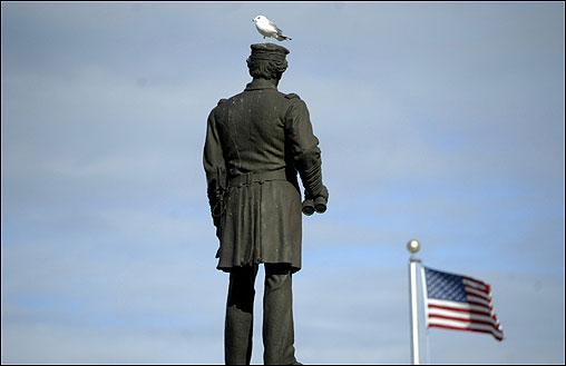 Civil War hero Admiral David Farragut and an avian friend stand guard.