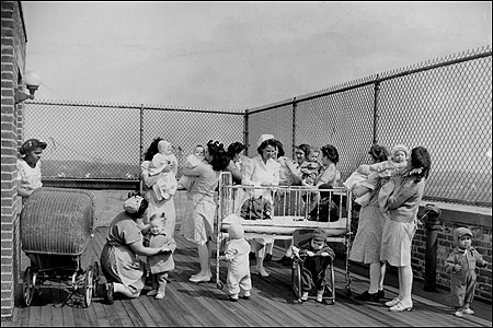 JAIL BABIES. Prisoners and their children sun themselves on a porch at Massachusetts' Reformatory for Women (as it was then known) in Framingham in March 1945. Today, according to a recent report by the Center for Women in Politics and Public Policy at UMass, inmates at Framingham - 71 percent of whom are mothers - have difficulty maintaining even basic contact with their children.