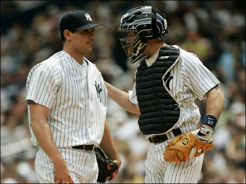 Yankees catcher John Flaherty attempts to settle down starting pitcher Carl Pavano. Pavano was taken out of the game in the fourth inning after giving up five runs.