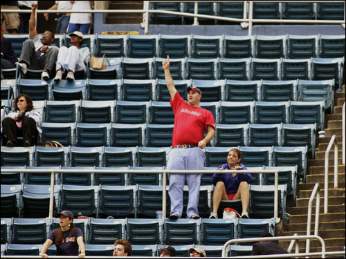 A Red Sox fan celebrates during the end of today's game in Yankee Stadium. Many Yankees fans made an early exit. 'Let's go Red Sox' chants could be heard loud and clear in the late innings in the Bronx.
