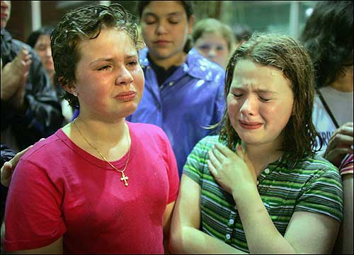 Evelyn Morano (left), 10, and Colleen Curry, 11, shed tears on June 8 after learning that their Brighton school was closing. <img src ='http://cache.boston.com/bonzai-fba/File-Based_Image_Resource/dingbat_arrow_icon.gif' alt='' title='' height='9' width='4' border='0' /> <a target='new' href ='http://www.boston.com/news/education/k_12/articles/2005/06/09/school_shuts_to_ward_off_parents'>Story