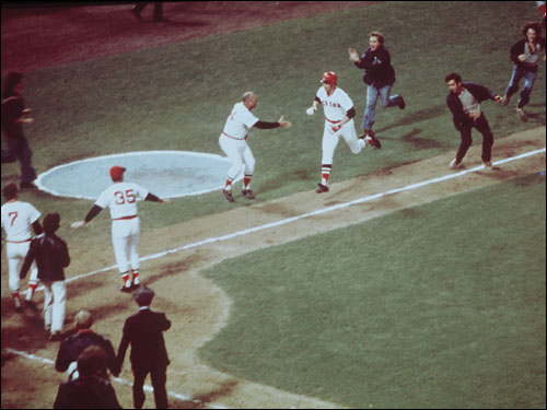 As Fisk rounded third, a few fans slipped out of the Fenway stands to make sure Pudge made his way home.