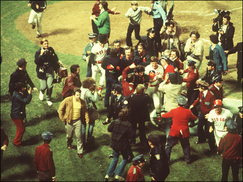 Even after the home-plate celebration was over, the Fenway field was still in chaos after Fisk's historic homer.