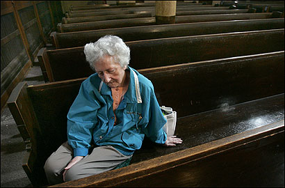 Esther Doherty, 78, of Everett, sat yesterday in 'her pew,' which she has been using since she was married 52 years ago at St. Therese Church. She is one of many parishioners hoping it stays open.