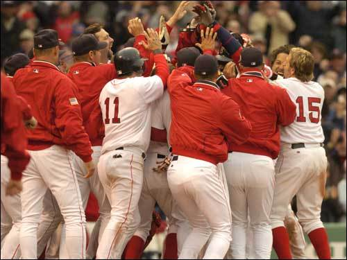 April 11, 2004 Red Sox 6, Blue Jays 4 Ortiz is surrounded after his 12th-inning, two-run home run over the Monster lifted the Sox over the Blue Jays.