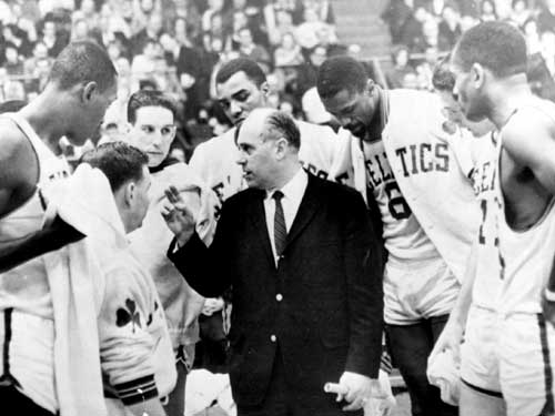 Auerbach talked to his team during a timeout in 1965. It would be Red's second to last season behind the Celtics' bench.
