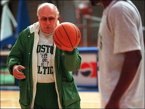 Although he wasn't as quick on the court as he used to be, Auerbach would still occasionally offer players on-the-court pointers, such as during this 1995 practice.