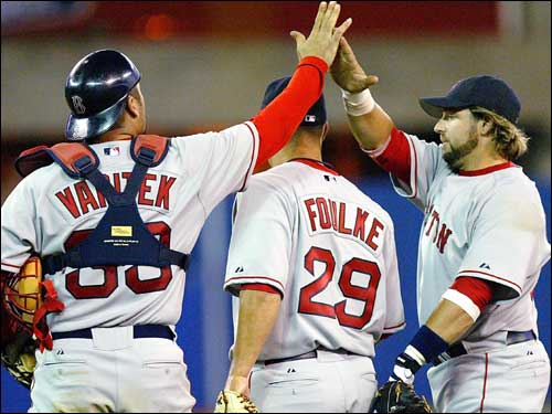 Jason Varitek and Kevin Millar joined Keith Foulke on the mound after a 6-5 victory in Toronto. Foulke entered the game with a 6-3 lead, gave up two earned runs, and left the tying run stranded at third base when the final out was recorded.