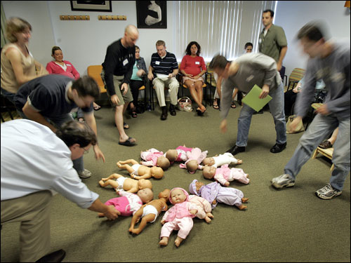 When Jason Varitek leaped into Keith Foulke's arms Oct. 27, 2004, they weren't the only ones embracing on that glorious night across Red Sox Nation. Nine months after Boston's World Series win, the newest Sox fans are coming to life. (Babies pictured are dolls)