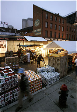 In the early morning hours, Haymarket vendors set up their stands.