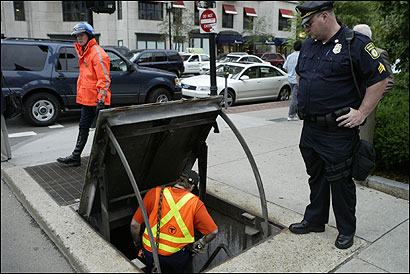 Maintenance personnel descended into an escape portal at Berkeley and Boylston streets yesterday following an MBTA train collision.