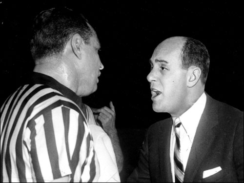 Even early on in his coaching career, Auerbach had a sometimes contentious relationship with officials. Here, Red drew an automatic $25 fine and technical foul for arguing with referee Arnie Heft in a 1955 game at the Boston Garden.