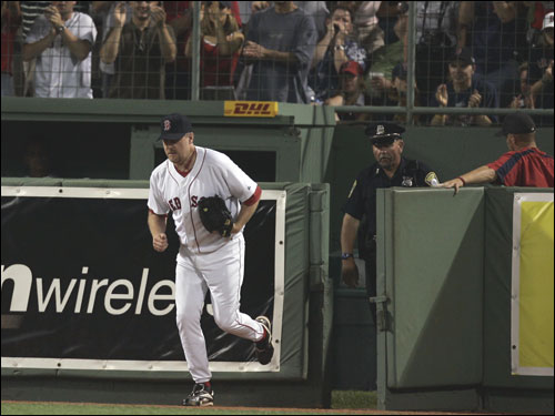 The Fenway Park crowd erupted when Schilling emerged from the bullpen to trot out for the ninth inning with Guns &#145;n Roses&#146; &#147;Welcome to the Jungle&#148; blaring.