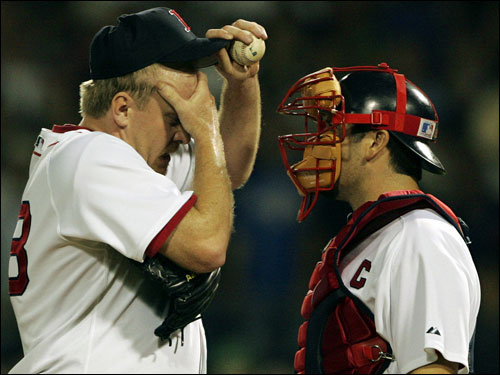 Red Sox catcher Jason Varitek talks up Schilling before the start of the ninth.