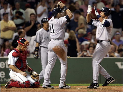 Sheffield congratulates A-Rod after scoring on Rodriguez's ninth-inning homer.