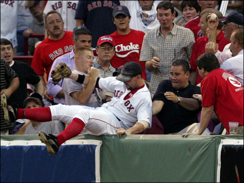 With the Yankees down, Jason Giambi led off the second inning and launched a 3-and-2 hanger down right-field line. Nixon gave chase, reached the wall, and jumped. Out of the tangle of arms emerged a stunning catch. Unfortunately for Nixon and the Sox, the arm belonged to a man in a pink dress shirt who spent much of the remainder of the inning on his cellphone, explaining his exploits. ''He didn't interfere in any way, shape, or form,' Nixon said. ''He just made a great catch.'