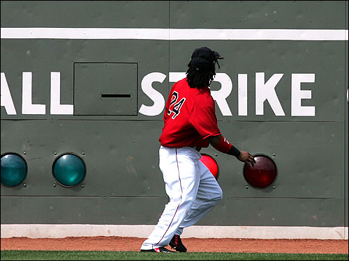 Red Sox left fielder Manny Ramirez looks up as John Flaherty's double hits off of the Green Monster at Fenway. At the Plate Ramirez went 2-for-4 and hit his 23rd homer of the season.