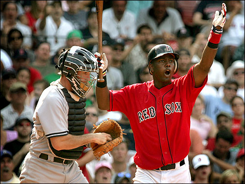 Edgar Renteria argues that he checked his swing. The first base umpire ruled he had swung, making Renteria the second out in the bottom of the ninth inning. Renteria went 1-for-5 in the game with a double.