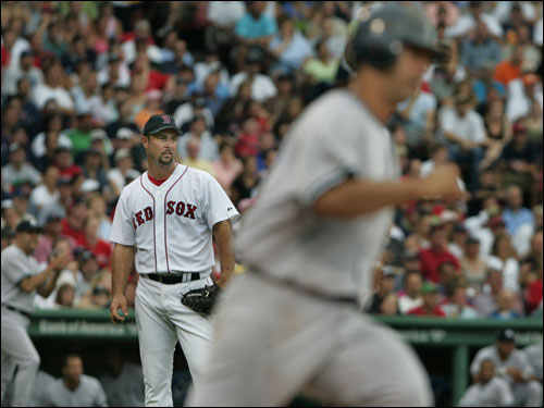 Tim Wakefield watches as Jorge Posada rounds the bases after his second-inning homer. Wakefield pitched a complete game, giving up five runs and striking out three.