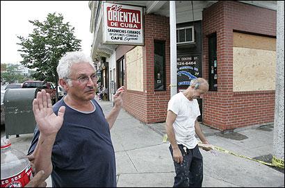 Nobel Garcia (L) vowed yesterday to reopen his El Oriental de Cuba restaurant. At right is building owner John Kariotis.