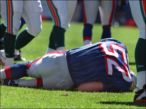 As a rookie, Johnson lies in a heap on the ground after being injured vs. Miami in September 1995.