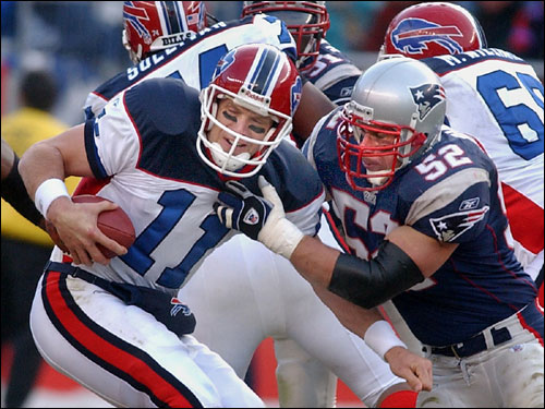 Johnson sacks Buffalo quarterback Drew Bledsoe at Gillette Stadium in January 2004.