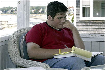 Wellesley High School senior Corey Testa, studying Advanced Placement psychology Friday on his porch in Hull, is unsure whether measures taken to ease stress at the school will work.