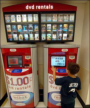 Brian Wilcox, 9, of Glastonbury, Conn., checks out the Redbox DVD vending machine at the Glastonbury Stop & Shop last month.