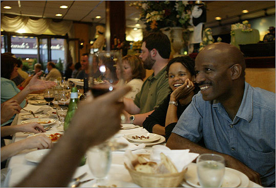 Venus Taylor, second from right, with her husband Hycel, out with friends at Limoncello restaurant in the North End