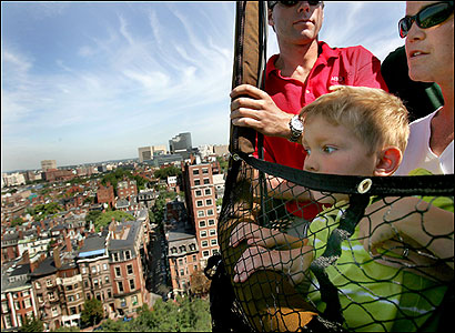 FLIGHT OF FANCY Five-year-old Mason Schimmel peered down on the city yesterday during a 10-minute hot air balloon ride that took off from Boston Common. The balloon was tethered to a wooden platform.