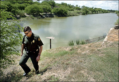 A Border Patrol agent, Chris Levy, at the Rio Grande near Brownsville, Texas. Many non-Mexican immigrants, facing summonses, are fleeing farther into the country.