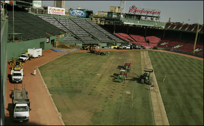 Once the Stones rolled out of town, the Red Sox were forced to roll in the tractors as they prepared to replace a section of Fenway Park's damaged outfield.