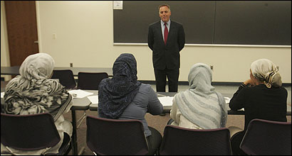 Ed Flynn of South Boston, a City Council candidate, spoke before Muslims at Northeastern University. Some Muslims have added concerns specific to their community to general neighborhood questions at such forums.