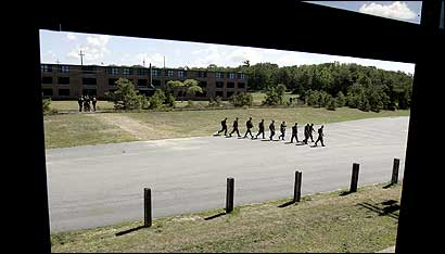 A squad of National Guardsmen headed back to barracks yesterday at Camp Edwards at Otis Air National Guard Base.