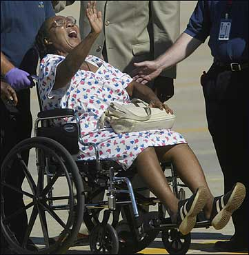 Gracie B. Beauvais of Independance, La., shouted, 'The Lord is with me' after she got off the plane.