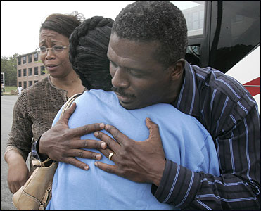 The Rev. Jeffrey Brown consoled evacuee Angela George of New Orleans inside the housing area yesterday in Bourne.