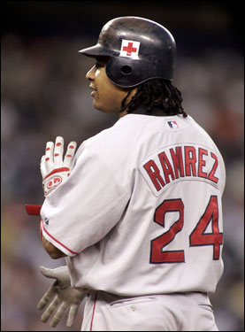 The Red Sox (Manny Ramirez pictured) and Yankees both wore Red Cross logos on their helmets last night.