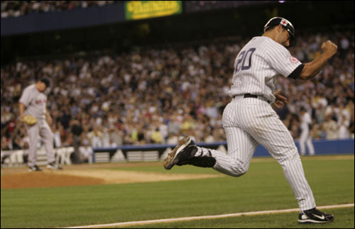 Jorge Posada pumps his fist after hitting a solo home run off David Wells in the second inning.