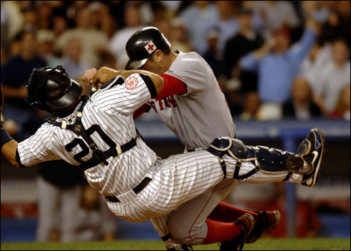 Jason Varitek is out at the plate after a collision with Jorge Posada in the third inning.