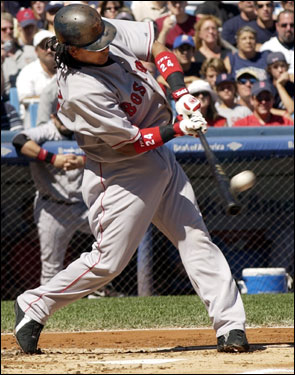 Manny Ramirez connected on a two-run home run to give the Red Sox an early lead in the first.