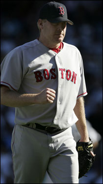 Curt Schilling pumped his fist after leaving the game in the eighth.