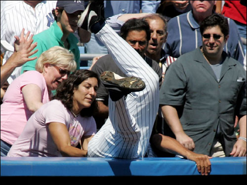Alex Rodriguez dove into the stands head first but could not come up with a foul ball in the first inning.