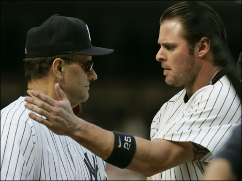 Giambi was congratulated by Joe Torre after driving in what would be the only run of the game.
