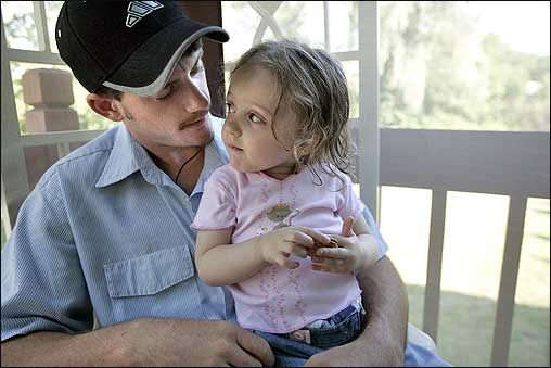 Eric Gossou, 21, shared a moment with his daughter, Tara Buyatt, 2, in the home of a friend's grandmother. The family, from Pascagoula, Mississippi, drove 1,800 miles to Taunton after their home was flooded from Hurricane Katrina.