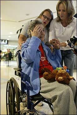 Tracey O'Dea (right) greeted her mother, Phyllis Sziladi (left), at Logan Airport Tuesday as Annmary Connor, a Social Worker with Harborside Healthcare Maplewood in Amesbury, Mass., looked on.